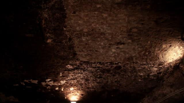 Wide shot of barrels inside wine cellar