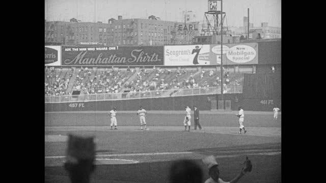 wide shot of baseball player hitting, running bases during game, yankee stadium, new york city, new york, usa - fielder stock videos & royalty-free footage