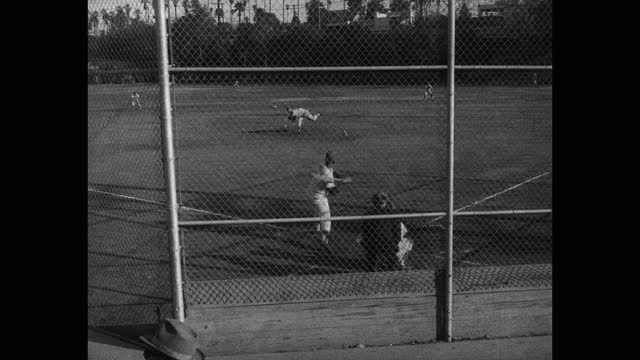 wide shot of baseball players playing game on baseball field - baseball strip stock videos & royalty-free footage