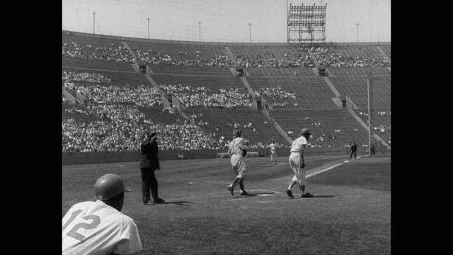 wide shot of baseball umpire watching baseball players playing game on baseball diamond - fielder stock videos & royalty-free footage