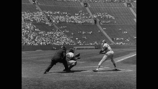 wide shot of baseball umpire watching baseball players playing game on baseball diamond - baseball diamond stock videos & royalty-free footage