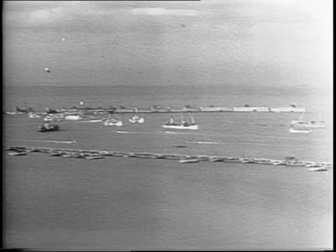 wide shot of beachhead and the floating harbors / views of prefabricated harbors - 1944 stock videos & royalty-free footage