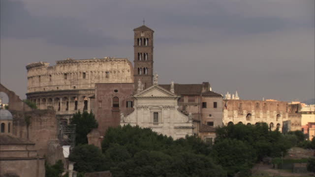 wide shot of birds flying over rome's colosseum in the early evening, italy. - bbc stock videos and b-roll footage