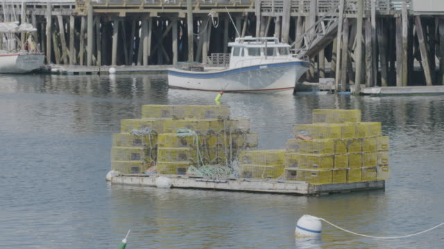 Wide shot of boats docked at a pier in Boothbay Harbor
