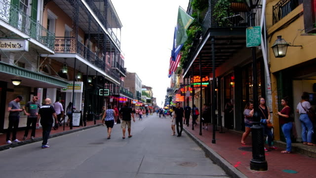 a wide shot of bourbon street in new orleans showing a street scene. - new orleans stock videos & royalty-free footage