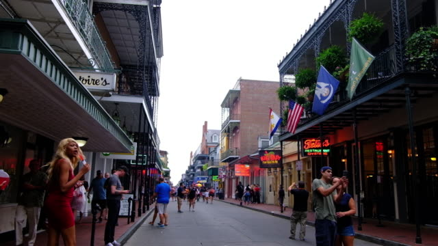 a wide shot of bourbon street in new orleans showing a street scene. - bourbon street new orleans stock videos and b-roll footage