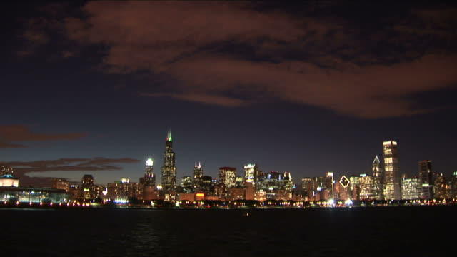 wide shot of buildings at night in chicago united states - shedd aquarium stock videos and b-roll footage