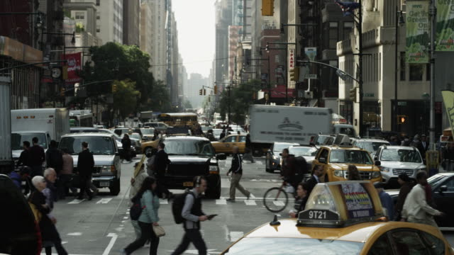 Wide shot of bustling city street / New York City, New York, United States