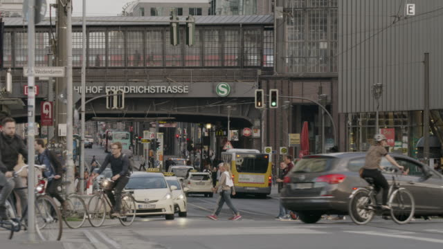 Wide shot of busy city intersection / Berlin, Germany