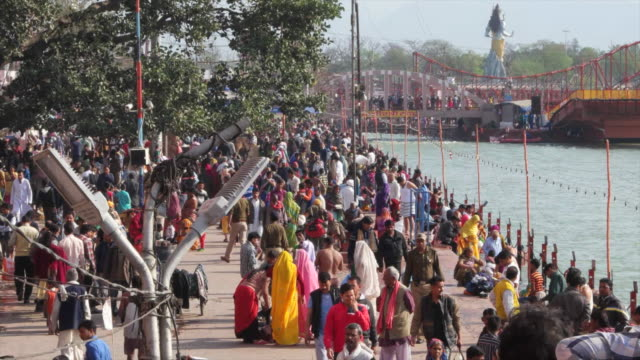 Wide shot of busy ghats of river Ganges at Haridwar, India