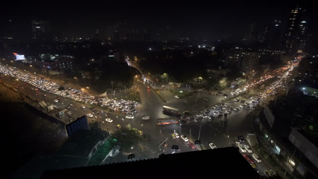 wide shot of busy traffic intersection in mumbai - wide stock videos and b-roll footage