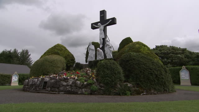 wide shot of calvary sculpture at knock shrine in knock, county mayo, ireland on august 23, 2018. - environment or natural disaster or climate change or earthquake or hurricane or extreme weather or oil spill or volcano or tornado or flooding stock videos & royalty-free footage