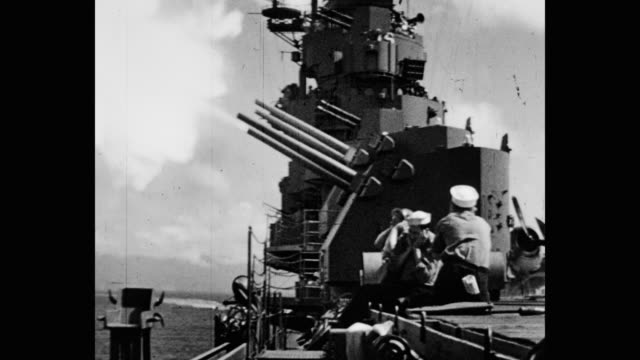 wide shot of cannon shooting from naval ship with sailors sitting in foreground - cannon stock videos & royalty-free footage