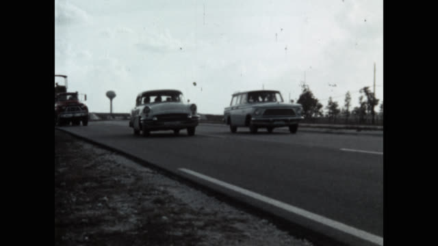 wide shot of car driving on road - colour image stock videos & royalty-free footage