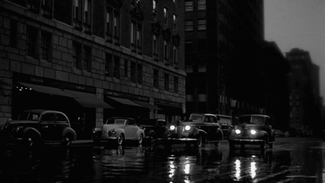 wide shot of cars driving on street at night, park avenue, new york city, new york state, usa - 1941 stock videos & royalty-free footage