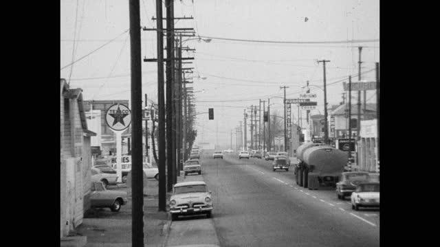 wide shot of cars driving on street in city, saugus, santa clarita, california, usa - santa clarita stock videos & royalty-free footage