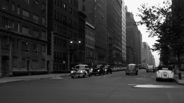 wide shot of cars driving on street with smoke emitting from manhole in city, park avenue, new york city, new york state, usa - 1941 stock videos & royalty-free footage