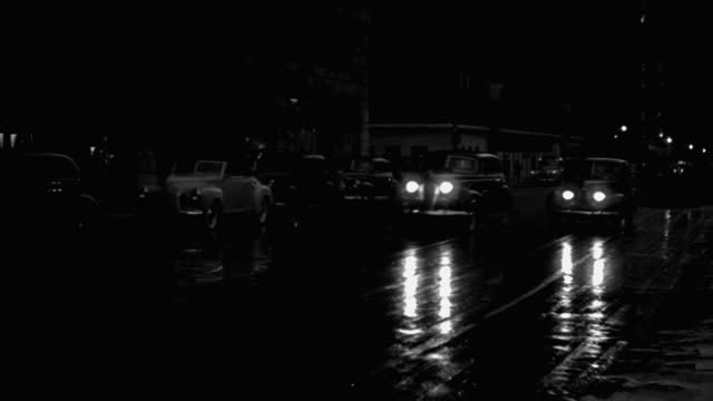 wide shot of cars driving on wet street at night, park avenue, new york city, new york state, usa - 1941 stock videos & royalty-free footage