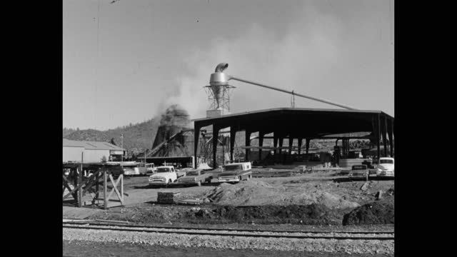 wide shot of cars parked in front of factory, sonora, california, usa - 1965 stock videos & royalty-free footage