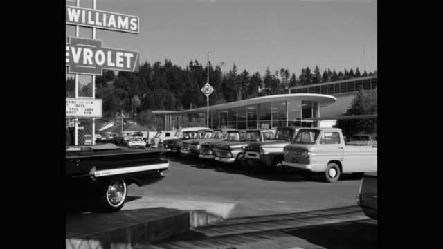 wide shot of cars parked outside lew williams chevrolet car dealership, eugene, oregon, usa - car showroom stock videos & royalty-free footage