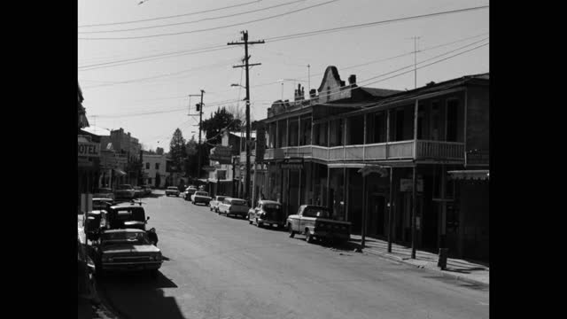 wide shot of cars parked outside two-story hotel building in small town, sonora, california, usa - 1965 stock videos & royalty-free footage