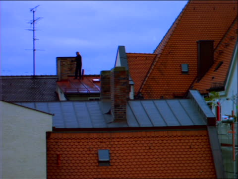 wide shot of chimney sweep on roof - 1992 stock videos & royalty-free footage