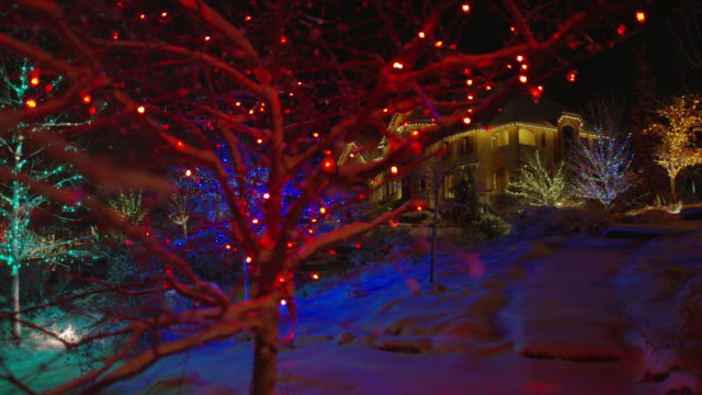 """wide shot of christmas decorations in snowy neighborhood / cedar hills, utah, united states"" - fairy lights stock videos & royalty-free footage"