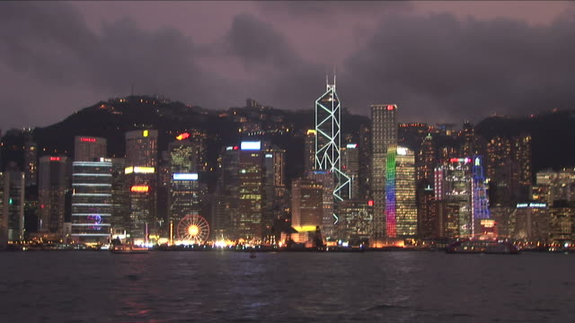 wide shot of city at magic hour in hong kong china - bank of china tower hong kong stock videos and b-roll footage