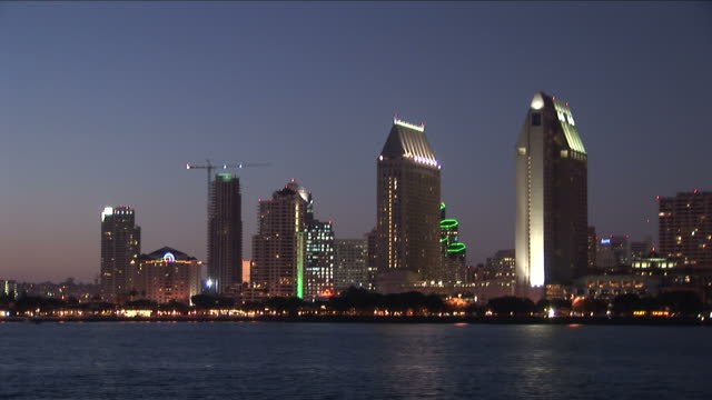 wide shot of city at magic hour in san diego united states - san diego stock videos & royalty-free footage