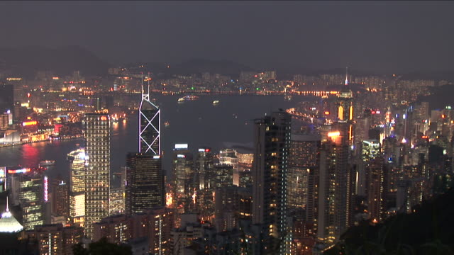 wide shot of city at night in hong kong china - wanchai stock videos and b-roll footage