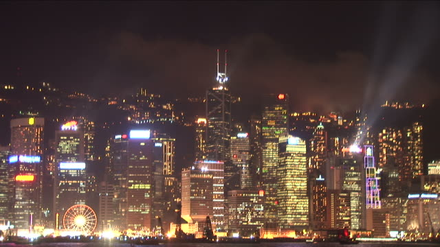 wide shot of city at night in hong kong china - bank of china tower hong kong stock videos & royalty-free footage