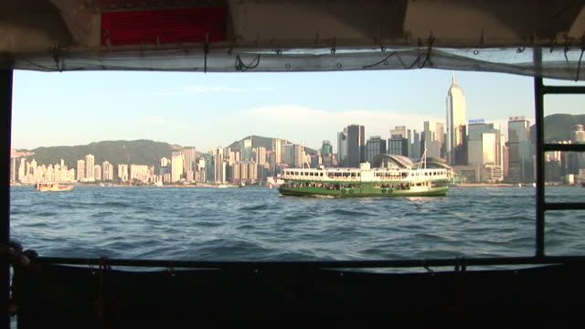 stockvideo's en b-roll-footage met wide shot of city from a moving ferry in hong kong china - star ferry
