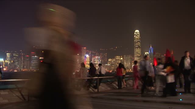 wide shot of city from the pier at night in hong kong china - bank of china tower hong kong stock videos & royalty-free footage
