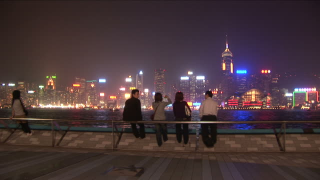 wide shot of city from the pier in hong kong china - central plaza hong kong stock videos & royalty-free footage
