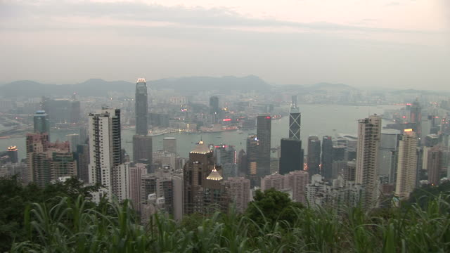 wide shot of city from victoria peak in hong kong - victoria peak stock videos & royalty-free footage