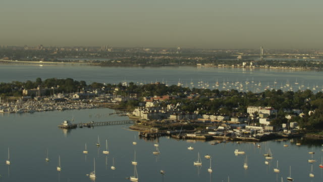 Wide shot of City Island homes with boats anchored in the harbor