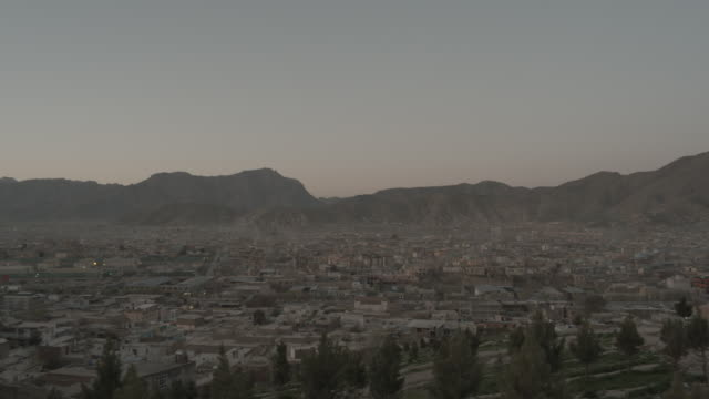 wide shot of city of kabul in the evening - kabul stock videos & royalty-free footage