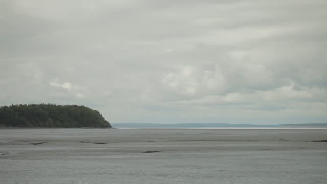 wide shot of clouds over a mud flat - mud flat stock videos and b-roll footage