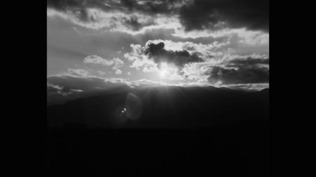 wide shot of cloudy sky during sunny day - black and white stock videos & royalty-free footage