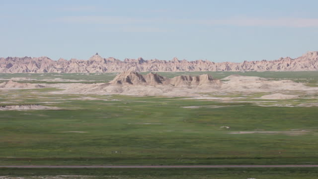 wide shot of crested buttes and prairies in badlands national park - badlands national park stock videos & royalty-free footage