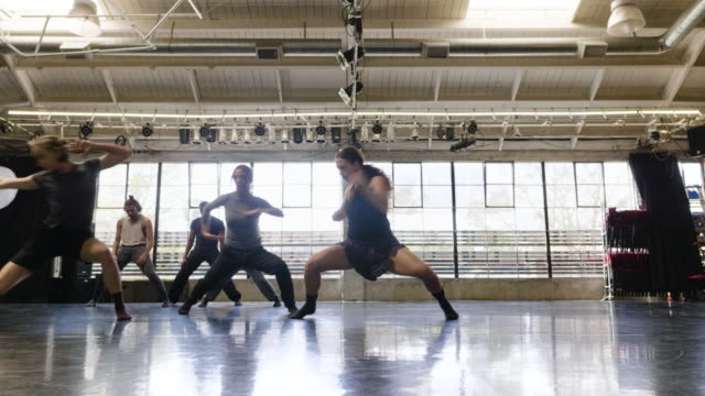 wide shot of dance troupe rehearsing in dance studio - dance studio stock videos & royalty-free footage