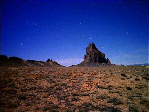 wide shot of desert with butte time lapse stars in day sky - time of day stock videos & royalty-free footage