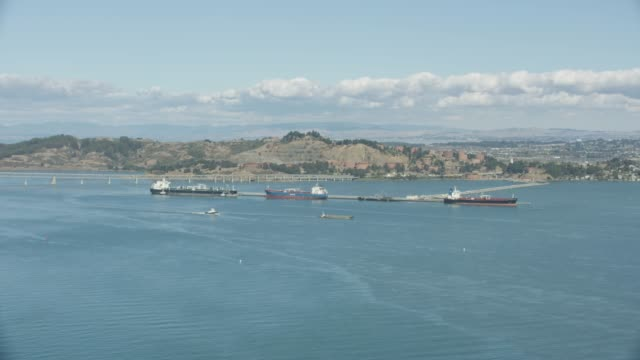 wide shot of docking tanker ships in the point richmond port - western usa stock videos & royalty-free footage