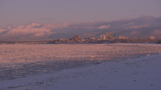wide shot of downtown anchorage and bootleggers cove viewed from point mackenzie at dusk - anchorage alaska stock videos & royalty-free footage