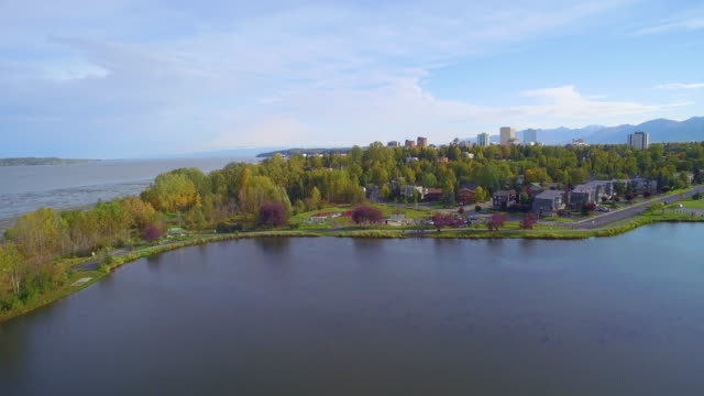 wide shot of downtown anchorage seen from above westchester lagoon - anchorage alaska stock videos & royalty-free footage