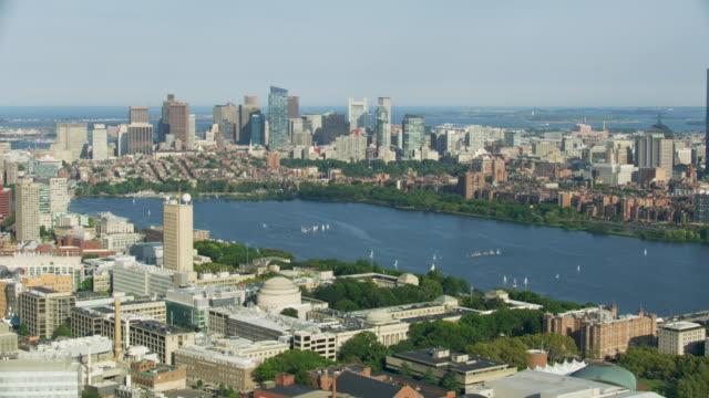 vidéos et rushes de wide shot of downtown boston seen from above cambridge - back bay