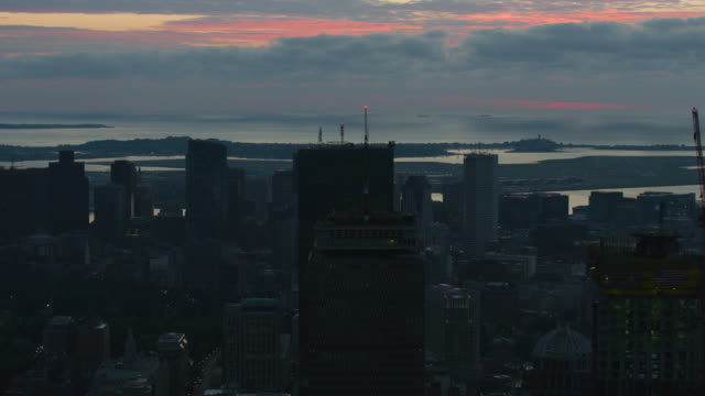 wide shot of downtown boston with the pink cloudy sky in the background at dawn - back bay boston stock videos & royalty-free footage