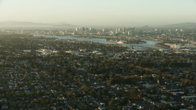 wide shot of downtown oakland and the coast guard island seen from above the alameda island - oakland california stock videos & royalty-free footage
