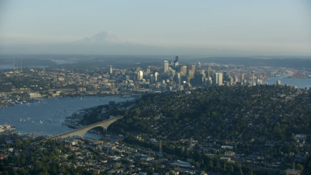 wide shot of downtown seattle with queen anne in the foreground - mt rainier stock videos & royalty-free footage