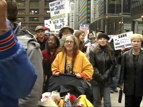 wide shot of elderly protestors walking past the camera at a march during ôoccupy chicago.õ senior citizens gathered in the city to join the protests... - anonymous activist network stock videos & royalty-free footage
